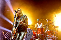 "Elizabeth ""Lzzy"" Hale and Arejay Hale on drums"
